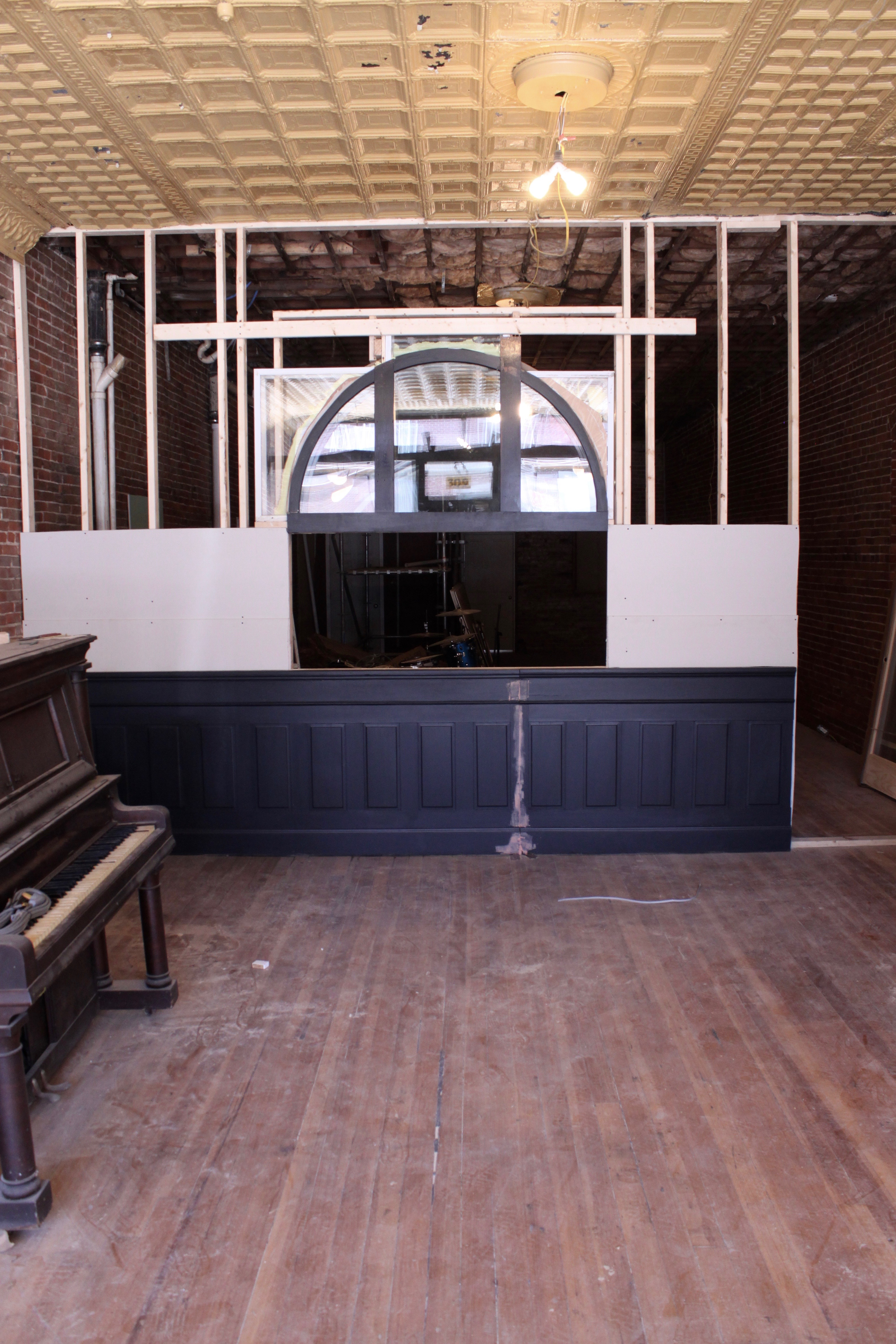 In The Rough Framing, The Window Sits Above Some Beautiful Room Divider  Panels Donated By Local Neon Sign Maker Jeff Dunn. The Piece Was In His  Familyu0027s Law ...